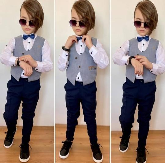 мальчик в костюме с галстуком бабочкой